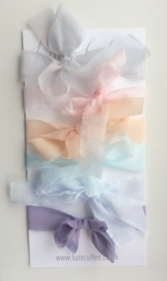 Hand painted silk ribbon ideal for stationery, wedding favours and gift wrapping sold by the metre in 2cm widths.