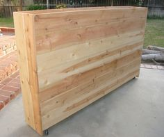 What an amazing idea, a rolling wall planter!  Great for patios and plenty of room for root growth!  I love this idea!