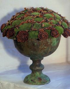 cones + moss in copper urn = texture