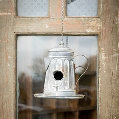 This Re-Purposed Coffee Pot Birdhouse adds vintage appeal to your front yard. We…