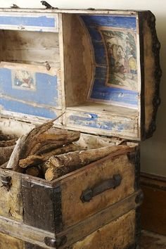 Nice way to store firewood AND make use of an old trunk that has seen better days -  A two-fer :)