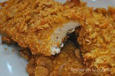 """""""Pollo frito"""" al horno. El resultado es muy jugoso, sabroso y de lo más crujiente sin aceite. Una receta que reduce grasas y nos ayuda a comer más sano."""