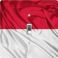"Rikki KnightTM Indonesia Flag - Single Toggle Light Switch Cover by Rikki Knight. $13.99. Washable. 5""x 5""x 0.18"". Masonite Hardboard Material. For use on Walls (screws not included). Glossy Finish. The Indonesia Flag single toggle light switch cover is made of commercial vibrant quality masonite Hardboard that is cut into 5"" Square with 1'8"" thick material. The Beautiful Art Photo Reproduction is printed directly into the switch plate and not decoupaged which make..."