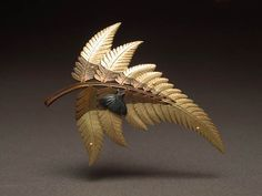 Japanese Sword-fern Pin, 18k gold, copper, and a shakudo moth by Jim Kelso