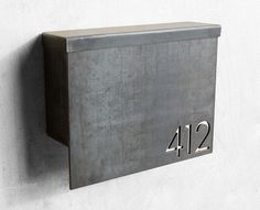 ***PRODUCT DESCRIPTION*** Our Gibson Custom Mailbox is composed of a 3/16 face plate with your custom address numbers cnc plasma cut right into the plate using our clean, modern font. The sides are made of 14 gauge steel to provide utility and keep the overall weight of the mailbox down. We now offer a locking option for this mailbox - the keyed lock feature allows for secure mail delivery and comes with two key copies. Please scroll through the pictures to see the dimensions. We build ...