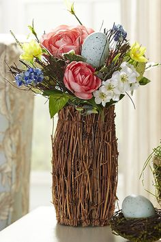 Filled with faux peonies, daisies and speckled eggs, this Vintage Garden Vine Vase from Pier 1 was made to be the center of attention, which makes it perfect for the center of your dining table.