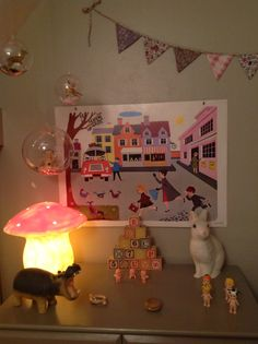 Kids room details with Heico Toadstool and Rabbit lamps, Bullyland hippo, bunting