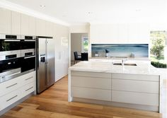 Printed image on glass kitchen splashback / backsplash by Lucy G. 'Waves 2' http://www.lucygsplashbacks.co.nzLucy works with customers all over the world.