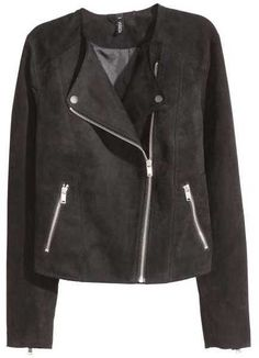 Biker jacket with a diagonal zip at the front. Lapels with decorative metal buttons, side pockets with zip, and zips at cuffs. Lined.