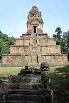 Angkor Wat: first a Hindu, and then a Buddhist temple complex in Cambodia and the largest religious monument in the world. It has become a symbol of Cambodia appearing on its national flag, and it is the country's prime attraction for visitors. [http://en.wikipedia.org/wiki/Angkor_Wat]