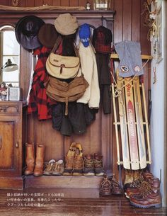 mudroom with boots and flannel and sled