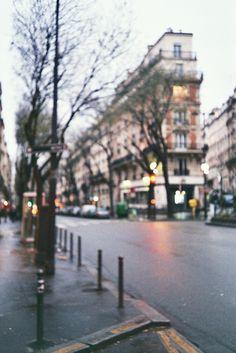 Blurry city street city lights outdoors winter street cold wet photography