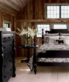 all the wood is so rustic and warm!  And I LOVE the black country-styled furniture with it!!!