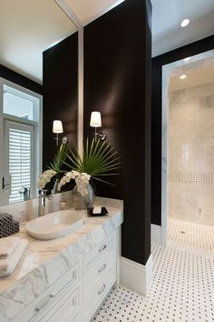 light fixture placement. Love this contemporary bathroom decorated in black, white and green.