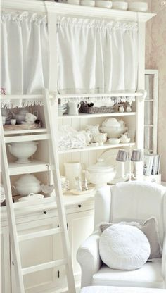 Shabby Chic Storage:  This is great! If you have things you don't want displayed, hang up a cafe curtain.