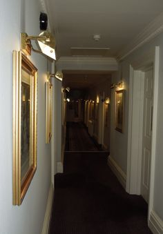 The corridors at The Grand Hotel, Brighton were decorated in a pale cream and of a good width with gilt framed paintings with over lights hung along the length making them welcoming spaces rather than dingy walkways.