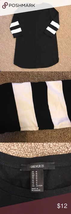 F21 baseball tunic dress black & white stripe med This is great to wear as a dress or tunic over leggings or skinny jeans. Two thick white arms sleeve stripes. Size medium. Excellent condition. Stretchy and substantial thickness/ weight. Forever 21 Tops Tunics