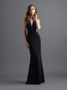 8920ec81dc Sparkling streamlined bands trace the bodice of this jersey gown