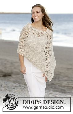 Knitted poncho with lace pattern in DROPS Bomull-Lin. Sizes S - XXXL. Free pattern by DROPS Design.