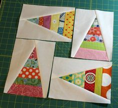 Scrappy Triangle blocks for Debbie/Blue.Ridge.Girl by flickrdeb50, via Flickr