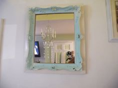 Stunning, elegant, romantic, wood, gesso Baroque ornate framed mirror painted in a very pale aqua blue backround ivory. $175.00, via Etsy.