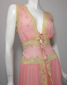Stunning pink silk 1940s nightgown with ecru lace trim and corset lace center to waist. Lace trimmed skirt and hem.