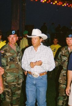 Another reason this man is Loved.Entertaing the soldiers? Country Western Singers, Country Men, Country Artists, Baby George, King George, Joyce Taylor, George Strait Family, Legendary Singers, Country Music Stars