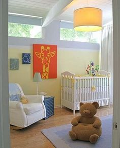 Soft yellow paint with bold wall accents to make baby happy.
