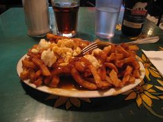 succumbing a guilty pleasure (here's some poutine from La Banquise in Montreal :)