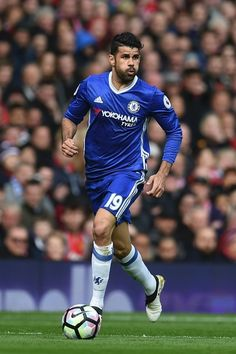 Chelsea's Brazilian-born Spanish striker Diego Costa controls the ball during the English Premier League football match between Manchester United and Chelsea at Old Trafford in Manchester, north west England, on April 16, 2017. / AFP PHOTO / Oli SCARFF / RESTRICTED TO EDITORIAL USE. No use with unauthorized audio, video, data, fixture lists, club/league logos or 'live' services. Online in-match use limited to 75 images, no video emulation. No use in betting, games or single…