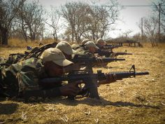 """""""You are going to be given a semi-automatic weapon when you finish this training. You will have 100th of a second to decide whether you can pull the trigger or not.""""  Vince Barkas runs a training course for anti-poaching rangers in #SouthAfrica. The course is tough and only a handful will pass the course. Watch #WildlifeWarzone to see how the new recruits cope under the pressure http://aje.me/1ah0S6C"""