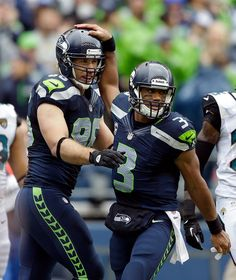 Seattle quarterback Russell Wilson (right) celebrates with tight end Zach Miller (left) after Miller caught a touchdown pass in the second quarter.