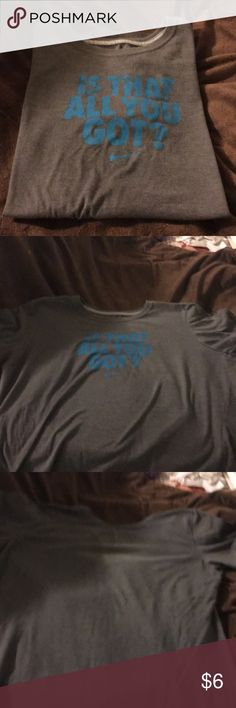 "Nike T-Shirt Nike gray T-Shirt with Turquoise writing. It says ""Is that all you got?"" And then the swoosh symbol is under that. It is labeled as an XL but Slim Fit. It doesn't fit like an XL, it fits more like a small medium to large. Any questions feel free to ask 😊 Nike Tops Tees - Short Sleeve"