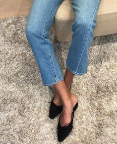 Pointed toe mules.