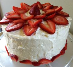 For summer, ice a cake with whipped cream and decorate with fresh strawberries.