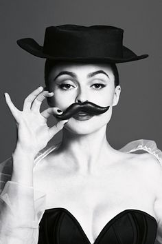 Who carries a fake moustache in their handbag? Helena Bonham Carter for Vogue July 2013