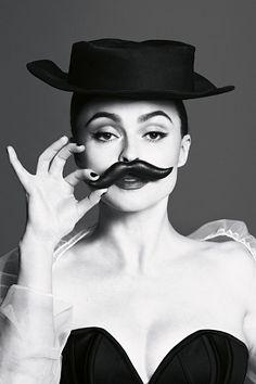 Who carries a fake moustache in their handbag? Helena Bonham Carter for Vogue July 2013