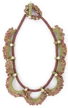 """Circlet of Lace has softness in its design that gives this piece a romantic side. The spaces between the Peyote stitched tubing and the inside edges of the lace shapes, have a """"peek-a-boo"""" effect on the skin. A Herringbone variation builds the base for all of the ruffled Netted shapes. Small bands embellished with pearls capture the tubing at intervals all along the necklace."""