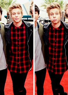 HIS OUTFIT AND FACE AND HAIR AND WOW. LUKE.