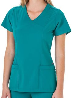 Style Code: Jockey Scrubs Clean-finished mock wrap top with princess lines for maximum shaping Bungee cord loop easily holds ID badge Signature zippered pocket keep valuables close and secure Side vents make movement easy. Center back length 26 inches. Scrubs Outfit, Scrubs Uniform, Stylish Scrubs, Beautiful Nurse, Suit Accessories, Medical Scrubs, Scrub Tops, African Dress, Bungee Cord