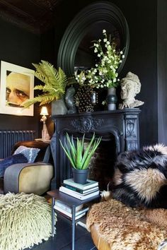 """Abigail Ahern shares her top decorating secrets: Hang art over doors """"This will visually raise your eye level, making your walls seem grander. Suddenly it will feel like you are living in a stately abode. Promise!"""""""
