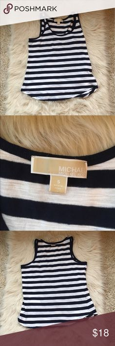 Michael kors tank top Michael kors tank top. In good used condition. Slight wear but no real damage. No holes, rips or stains. Super cute and perfect for warm weather Michael Kors Tops Tank Tops