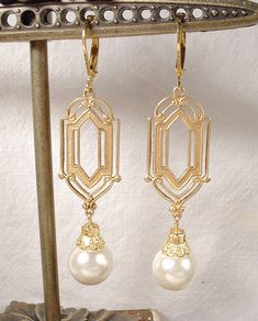 *NEW* Offering a gorgeous pair of gold classic Art Deco style pearl dangle earrings. Earrings hang down just under 2 1/4 inches (5.7 cm) from the top of the ear wire; pearls are 12mm in diameter. These feature satiny vintage simulated light ivory pearls topped with an ornate bead cap