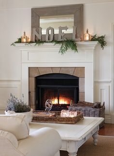 """This very high mantle has an imposing, theatrical quality that adds dimension to the room. The casual holiday decor is a great example of less-is-more."""
