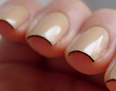 Nude nails wrapped with black