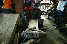 PHOTO OF THE WEEK: 13 August 2012 - Children who live on the streets face myriad abuses and rights violations, including doing exploitative work to survive. Girls are especially vulnerable. Here…a 15-year-old sex worker (foreground) sleeps on a bench at an outdoor restaurant in Abidjan, Côte d'Ivoire. Her clients are mostly older men; for protection, she lives among the adolescent boys who surround her. ©UNICEF/Kamber - To see more: www.unicef.org/photography