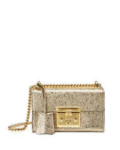 """Gucci metallic leather shoulder bag with a cracked laminate effect. Sliding chain strap can be doubled, 11""""-20"""" drop. Flap top with push-lock clasp. Hanging covered key. Back slip pocket. Interior, mi"""