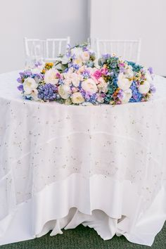Sweetheart table decor- simple, but stunning! // Photographer: Sarah Tew Photography, Floral Design: Rebecca Shepherd Floral Design // see more: http://theeverylastdetail.com/2013/09/04/modern-romantic-lavender-blue-wedding/