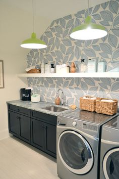 A gorgeous wallpaper in the laundry room makes the space a pretty place to be in, but open shelving and clever storage options make it super-functional too