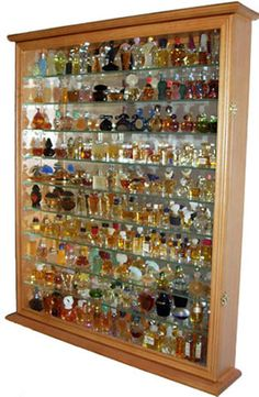 Gorgeous solid wood display case to hold plenty of perfume bottles that you have collected over the years. 9 tempered glass shelves provide plenty of rooms to showcase. Hinged glass door to save you from dusting. Mirror background to reflect light and creates an elegant contrast. Wall mountable with metal brackets on the back of the display case. The surface is repeated sanded to achieve a very smooth surface. Comes in one piece and no assembly is required. You need only to hang it and put…